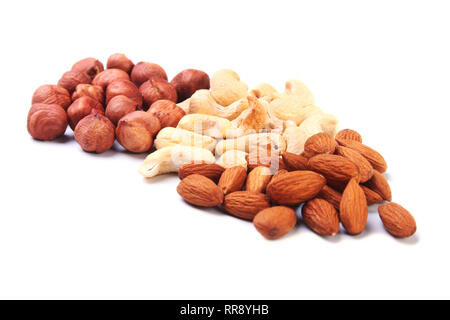 Mixed nuts from hazelnuts, almonds, cashews isolated on white background. Selective focus. - Stock Photo