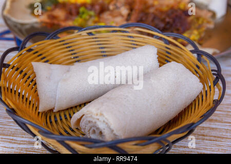 African food.  Rolls of Injera - a sourdough flatbread made from teff flour.  It is the national dish of Ethiopia, Eritrea, Somalia and Djibouti - Stock Photo