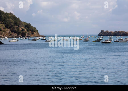 Cancale, France - September 15, 2018: Fishing boats and yachts moored in the bay at high tide in Cancale, famous oysters production town. Brittany, Fr - Stock Photo
