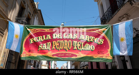 Suspended above the street is a banner proclaiming the Arts Fair in San Telmo district of Buenos Aires, Argentina. - Stock Photo