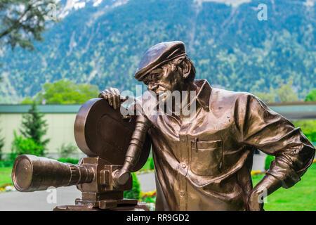 Statue of famous Indian filmmaker, Yash Chopra, at Casino Kursaal in Interlaken, Switzerland. - Stock Photo