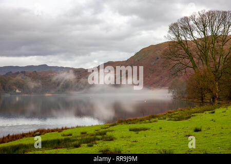 Early morning mist above Grasmere Lake, Grasmere in the Lake District national park,Cumbria,England - Stock Photo
