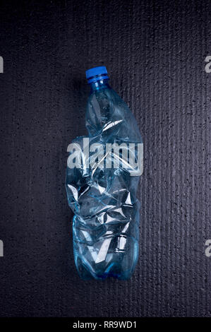 Bottle  trash. Danger of environmental pollution.Ecology concept on black background. Environmental concept. - Stock Photo