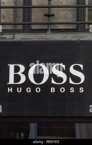 London, UK - 17, December 2018: Close up of the Hugo Boss logo above the store in London, UK - Stock Photo