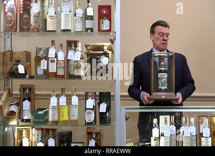 Bonhams whisky expert Martin Green with a bottle of the very rare Macallan-60 year old-1926, that has a label designed by the eminent, internationally acclaimed, British pop artist Sir Peter Blake, which is valued at £500000-£700000 as part of Bonhams Whisky sale on Wednesday March 6. - Stock Photo