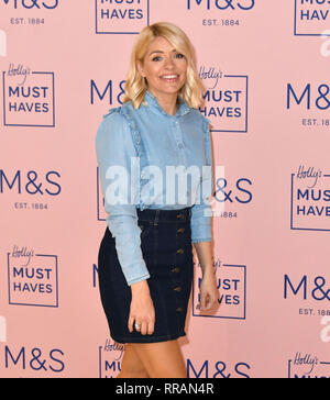 London, UK. 25th Feb 2019. Holly Willoughby, This Morning presenter hosts press launch to celebrate her new Must-Haves collection with Marks & Spencer, at Marks & Spencer, Westfield London Shopping Centre.  Holly wears M&S Collection Top £32.50. M&S Collection Skirt £25. M&S Collection Boot £55 Credit: Nils Jorgensen/Alamy Live News - Stock Photo