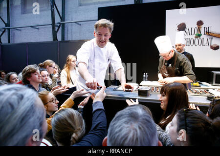 Brussels, Belgium. 24th Feb, 2019. Famous Belgian chocolatier Pierre Marcolini prepares chocolate dessert in Salon du Chocolat. Credit: ALEXANDROS MICHAILIDIS/Alamy Live News - Stock Photo