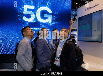 Barcelona, Spain. 25th Feb, 2019. Visitors to the Mobile World Congress technology trade show can take a look at the new products at Qualcomm's booth. The Mobile World Congress in Barcelona runs until 28 February. Credit: Clara Margais/dpa/Alamy Live News - Stock Photo