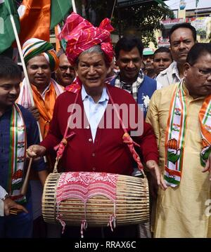Guwahati, Assam, India. 25th Feb, 2019. Congress General Secretary Harish Rawat beating a Assamese Traditional Dhol(Drum) during flagged off Prachar Yatra for publicity of Congress President Rahul Gandhi's Rally in Guwahati on Monday, 25 February 2019. Credit: Hafiz Ahmed/Alamy Live News - Stock Photo