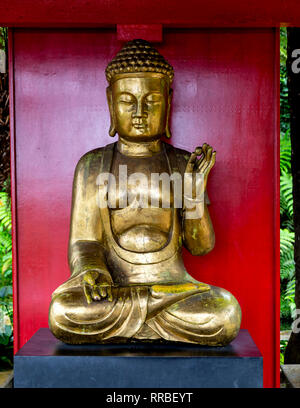Golden Buddha statue in the Japanese garden, Monte Palace Tropical Gardens, Funchal, Madeira, Portugal. - Stock Photo