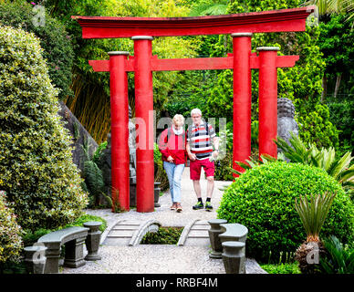 Senior couple walking in the Japanese garden, Monte Palace Tropical Gardens, Funchal, Madeira, Portugal.