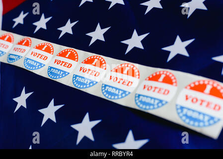 Sticker strip I vote today on the USA flag after voting in the ballot box. - Stock Photo