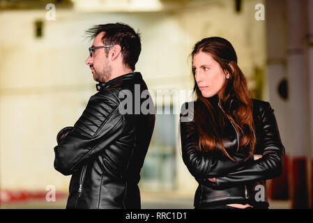 Couple in love angry after an argument, with their backs to each other. - Stock Photo