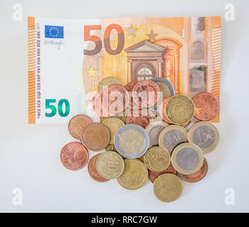 50 Euro banknote with cents and Euro coins; foreign money banknote and coins fo different denominations - Stock Photo
