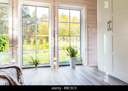 Bright interior, room in wooden house with large window. Scandinavian style. - Stock Photo
