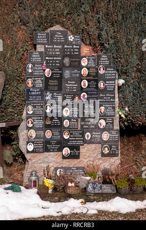tombstone with many name plates on the cemetery in Malmedy, Belgium, Europe.  Grabstein mit vielen Namensplaketten auf dem Friedhof von Malmedy, Belgi - Stock Photo