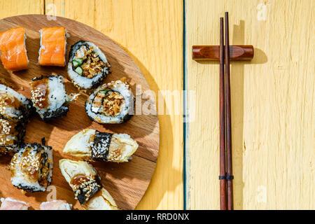 Rolls set on wooden board - Stock Photo