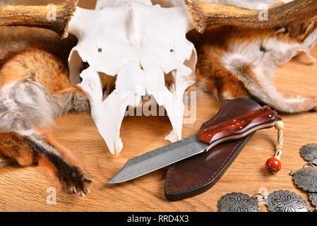 Unique Hunting Damask Knife on Slate Background - Stock Photo