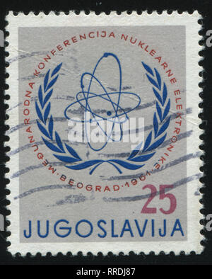 RUSSIA KALININGRAD, 12 NOVEMBER 2016: stamp printed by Yugoslavia, shows International Atomic Energy Comission Emblem, circa 1961 - Stock Photo