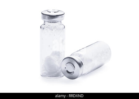 Bottles for injection with white powder on a white background - Stock Photo