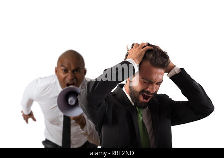 Boss scolds with megaphone a desperate employee with a verbal aggression - Stock Photo