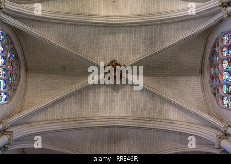 Toledo, Castille la Mancha, Spain - April 04, 2017: Arch ceiling and Heraldic shield inside Cathedral (Catedral Primada de Toledo) - Stock Photo