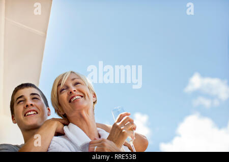Mother and son standing on deck of cruise ship. - Stock Photo