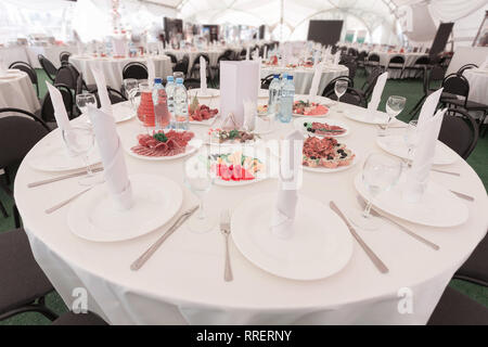 table set for a Banquet in a trendy restaurant - Stock Photo