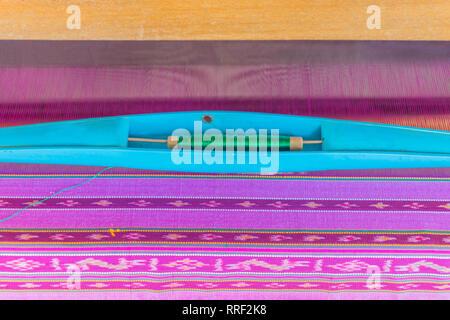 Colorful Thai silk, Thai silk yarn.Thai traditional weaving work, the surface texture of Thai silk, an ancient method. - Stock Photo