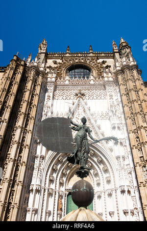 La Giralda weather vane at the Entrance of the Prince at The Cathedral of Saint Mary of the See also known as the Seville Cathedral - Stock Photo