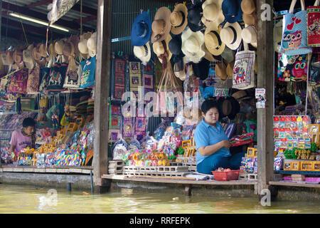 Damnoen Saduak, Thailand - August 29, 2018: Gift shop on the shore of the canal in Damnoen Saduak Floating Market, Ratchaburi, Thailand. - Stock Photo