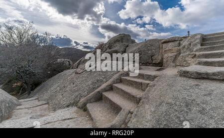 Celtic Vetton sacred space (Nemeton) Altar of sacrifices sculpted in granite rock known as Silla de Felipe II (Phillip II chair) in Guadarrama Mountai - Stock Photo
