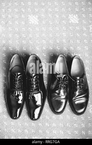 High Angle View of Two Pair of Men's Shoes - Stock Photo