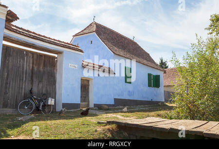 Prince Charles' house, a blue roadside cottage guesthouse in the small historic Saxon village of VIscri, Transylvania, Romania - Stock Photo