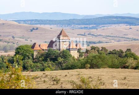 Viscri fortified church: a Lutheran fortified church in Viscri, Brasov County, in the Transylvania region of Romania - Stock Photo