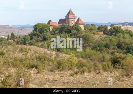 Viscri fortified church: a Lutheran Romanesque style fortified church in Viscri, Brasov County, in the Transylvania region of Romania - Stock Photo