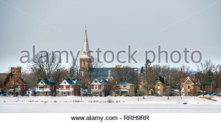 Houses and church on the shore of Little Lake Peterborough Ontario Canada - Stock Photo