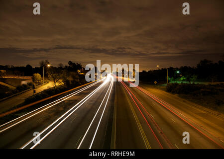 Very clean D-SLR long exposure. No noise. West Los Angeles skyline at night with traffic streaking by on the 405 freeway. - Stock Photo