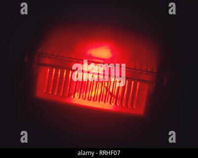 Glowing Red Power Switch in the Dark Macro Closeup - Stock Photo