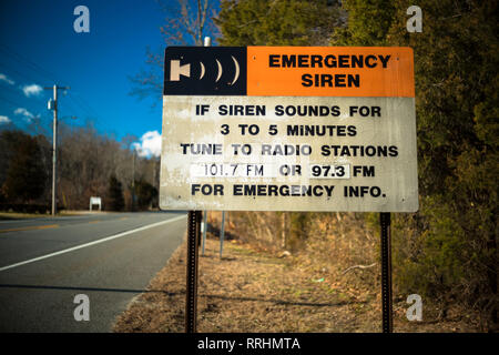 Emergency Signal Siren Sign along country roadside. - Stock Photo