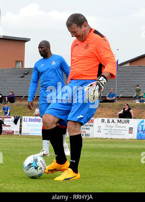 IRVINE, SCOTLAND - 3rd JUNE 2018: Marvin Andrews and Andy Goram playing in the Old Firm Greats match in Irvine. - Stock Photo