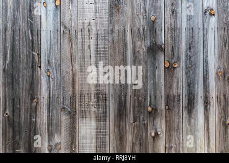 Old rustic weathered wood barn siding background - Stock Photo