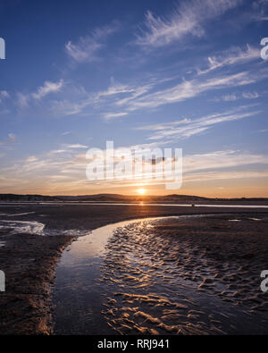 Looking at the setting sun across the Exe estuary towards Starcross from Exmouth, Devon, England, United Kingdom, Europe - Stock Photo
