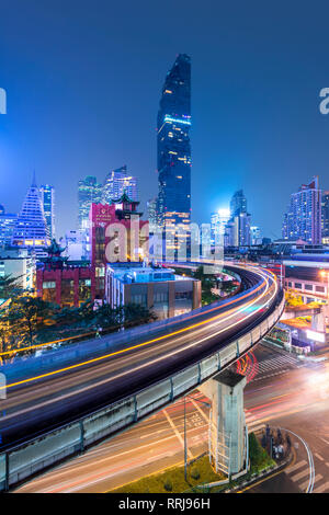 Mahanakhon building and BTS skytrain at Silom Road, Bangkok business district, Bangkok Thailand, Southeast Asia, Asia - Stock Photo