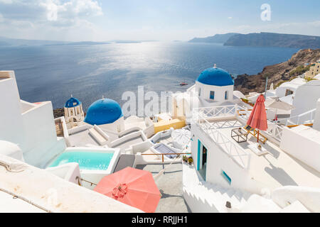 View of blue domed churches from cafe in Oia village, Santorini, Cyclades, Aegean Islands, Greek Islands, Greece, Europe - Stock Photo