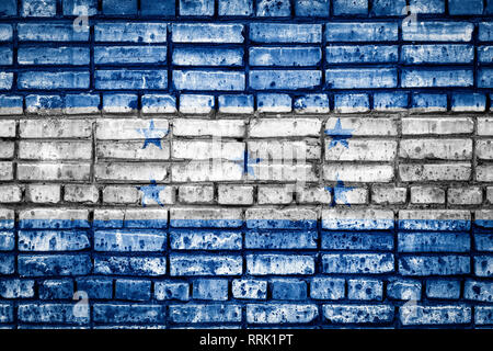 National flag of Honduras on a brick background. Concept image for Honduras: language , people and culture. - Stock Photo