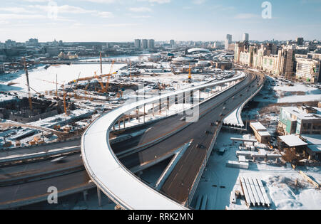 Aerial drone view of construction site; cranes and machines; new segment of road junction; development of modern infrastructure in Chelyabinsk; panora - Stock Photo