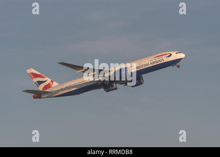 British Airways Boeing 777 jet airliner plane G-ZZZB taking off from London Heathrow Airport, UK. Airline flight departure - Stock Photo