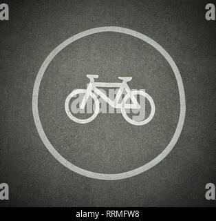 Bicycle sign on asphalt texture marking cyclist lane on a road. - Stock Photo