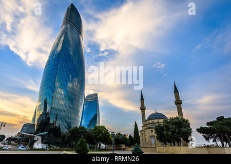 Mosque of the Martyrs and modern glass central business district skyscrapers in the sunset, Baku, Azerbaijan - Stock Photo